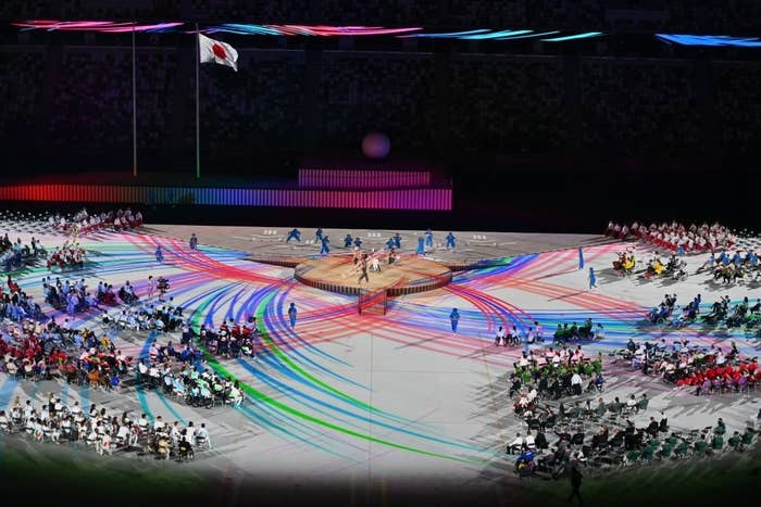 Performers and delegations take part in the opening ceremony for the Tokyo 2020 Paralympic Games at the Olympic Stadium in Tokyo