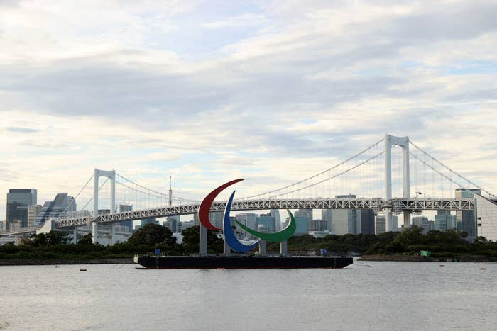 A general view of the 'Three Agitos' Paralympic Symbol is seen in front of the Rainbow Bridge at Odaiba Marine Park