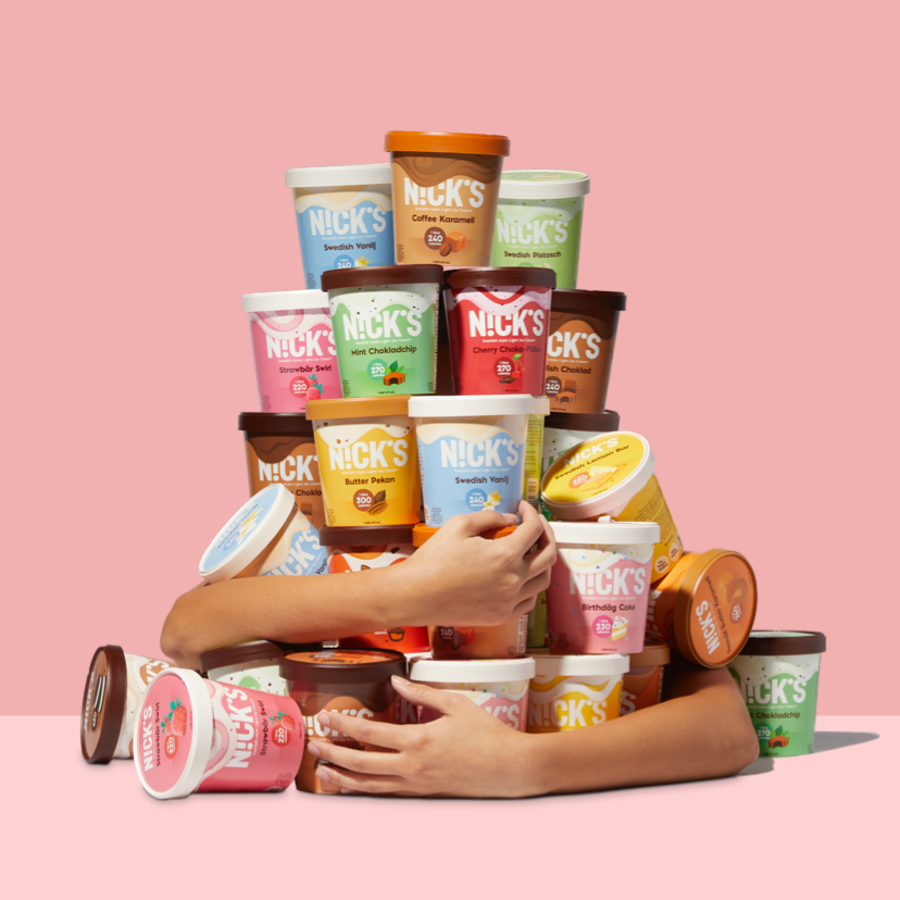 arms around a bunch of pints of ice cream