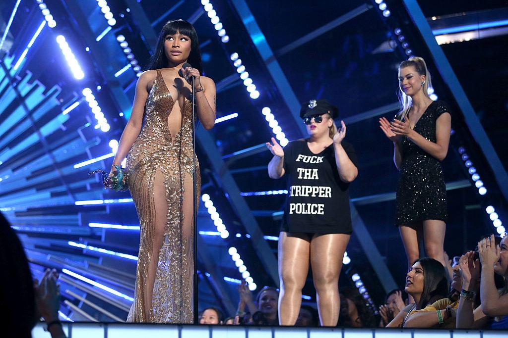 Nicki Minaj giving her speech, talking into the mic on stage at the 2015MTV VMAs