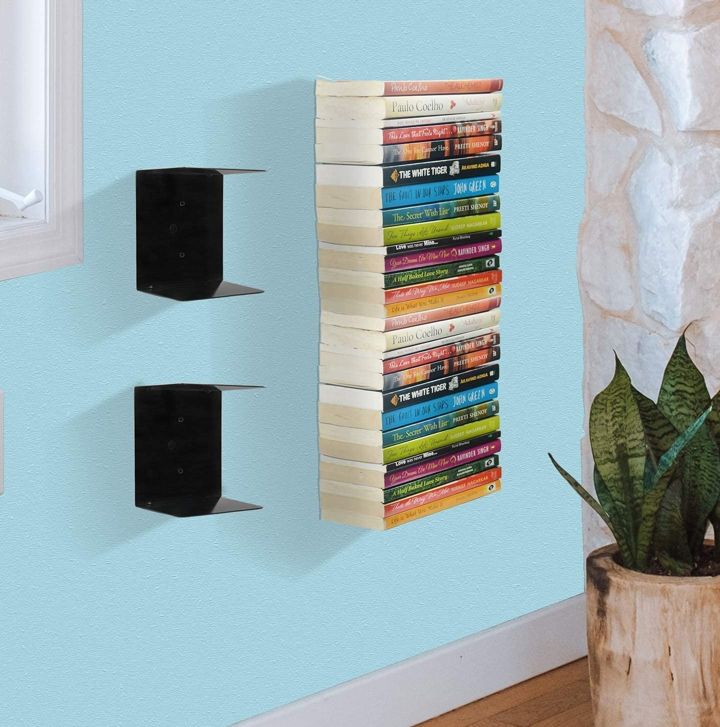 2 bookshelves filled with books seeming to float mounted on a wall