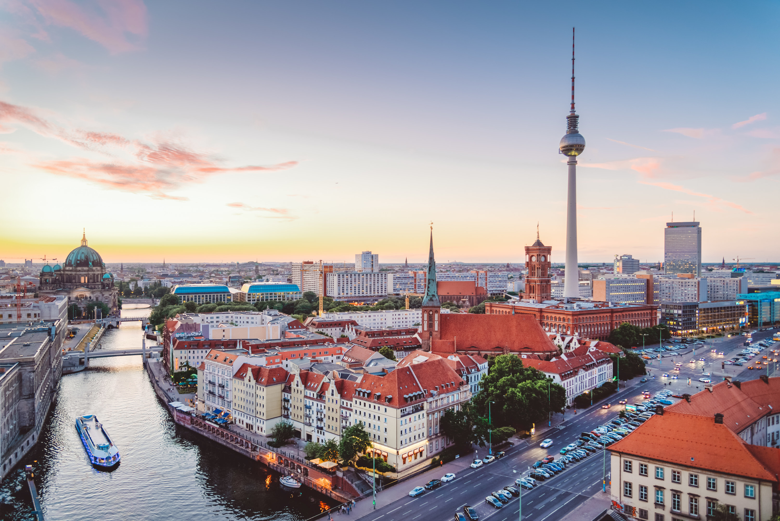 View of Berlin's TV tower, Berlin's main river, and other city landmarks with a sunset in the background