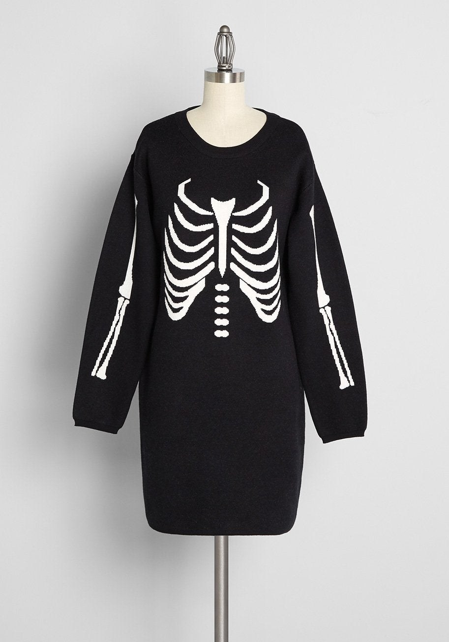 a black long sleeve sweater dress with a skeleton design on it