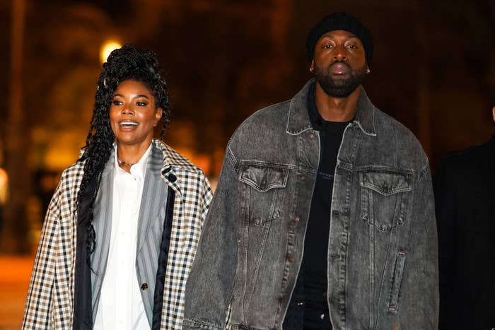 Gabrielle and Dwyane, both casually dressed, walking outside at night