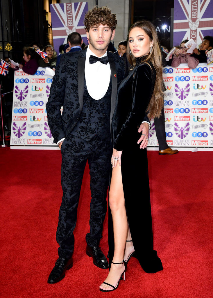 Eyal, in an embroidered suit, and Delilah, in a velvet gown, pose for photographers on the red carpet of Pride of Britain awards