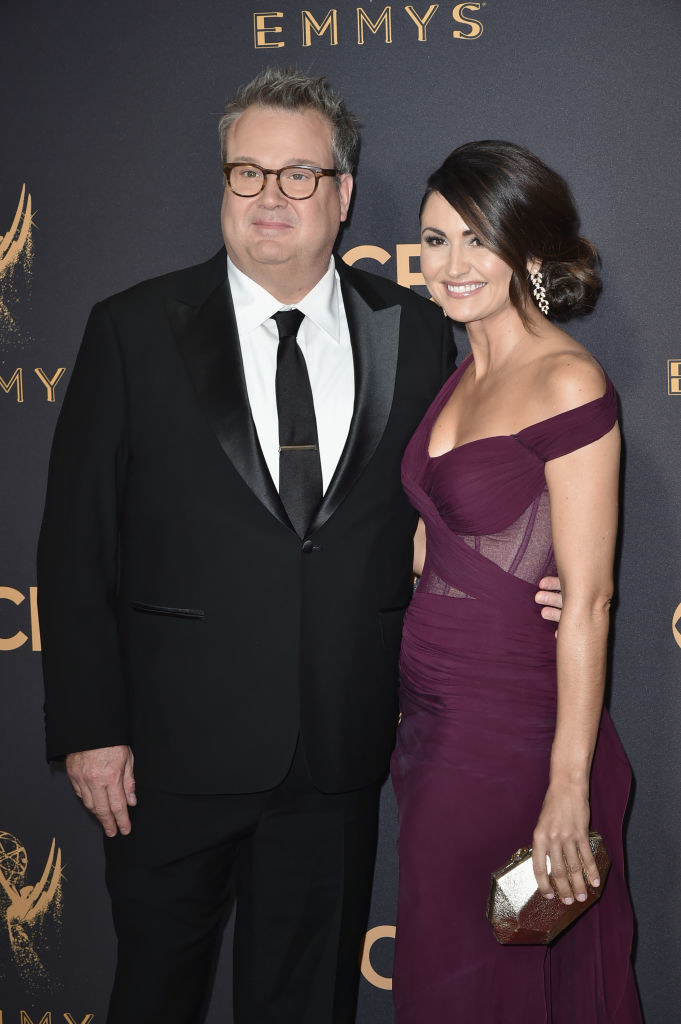 Eric and Lindsay posing together at the Emmys for a photo