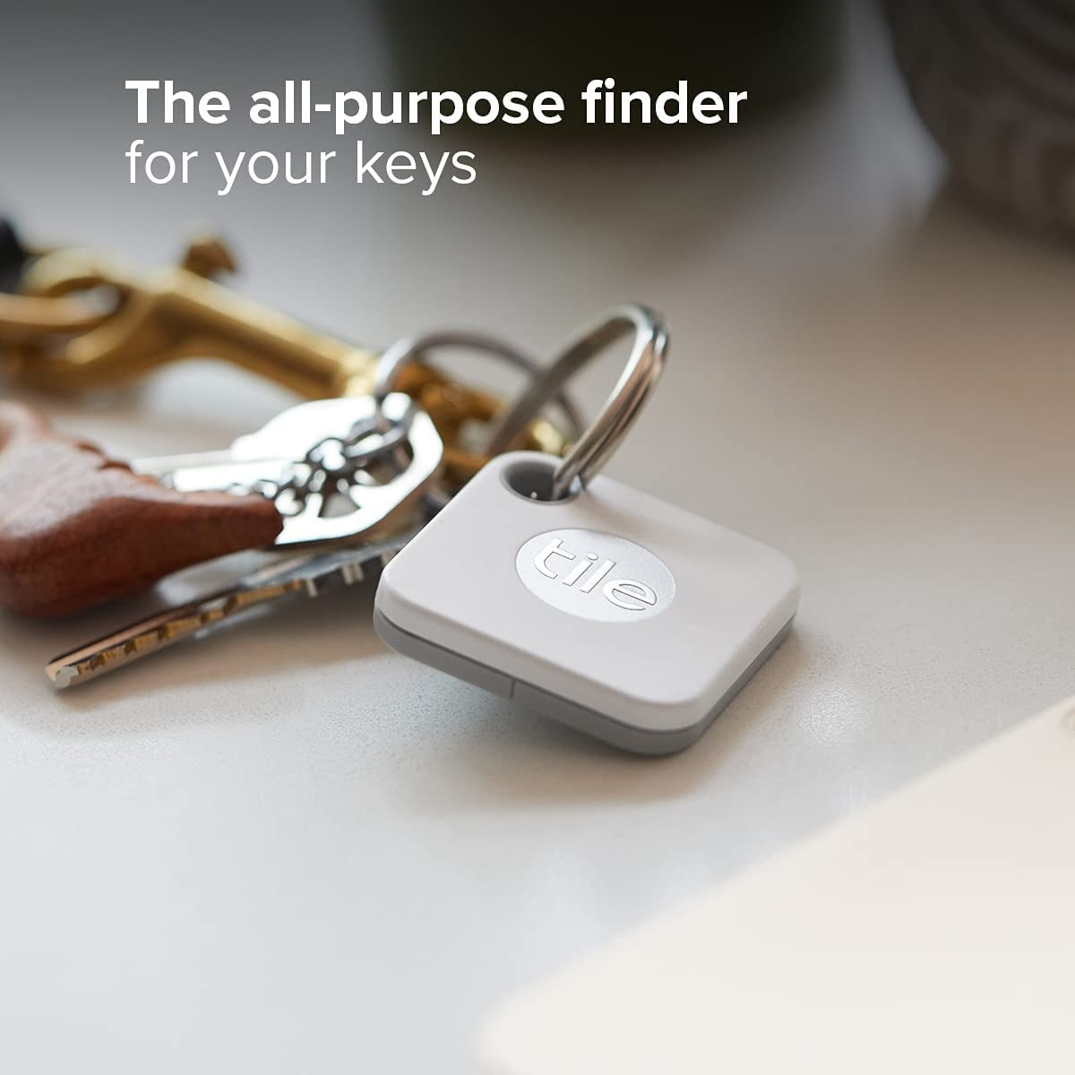 White square shaped tile keychain attached to keys
