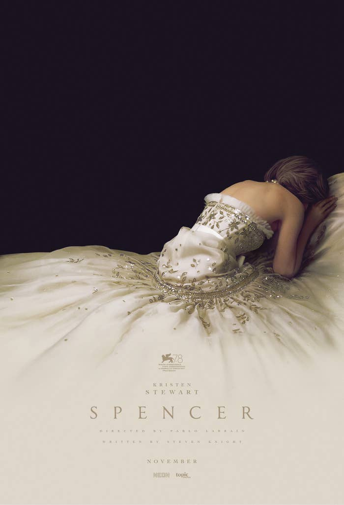 Kristen as Diana bent over on the ground with her ornate strapless gown flowing out around her