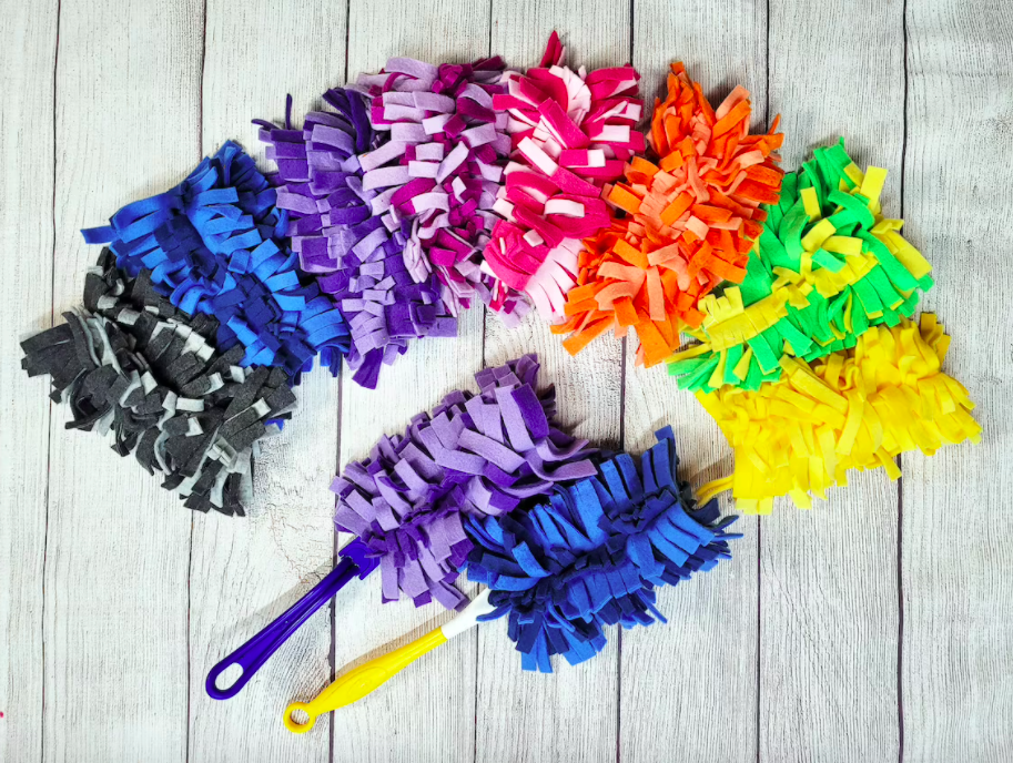 The Swiffer style dusters in every color available laid out on a floor