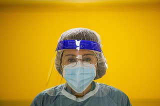 Doctor wearing a mask and face shield