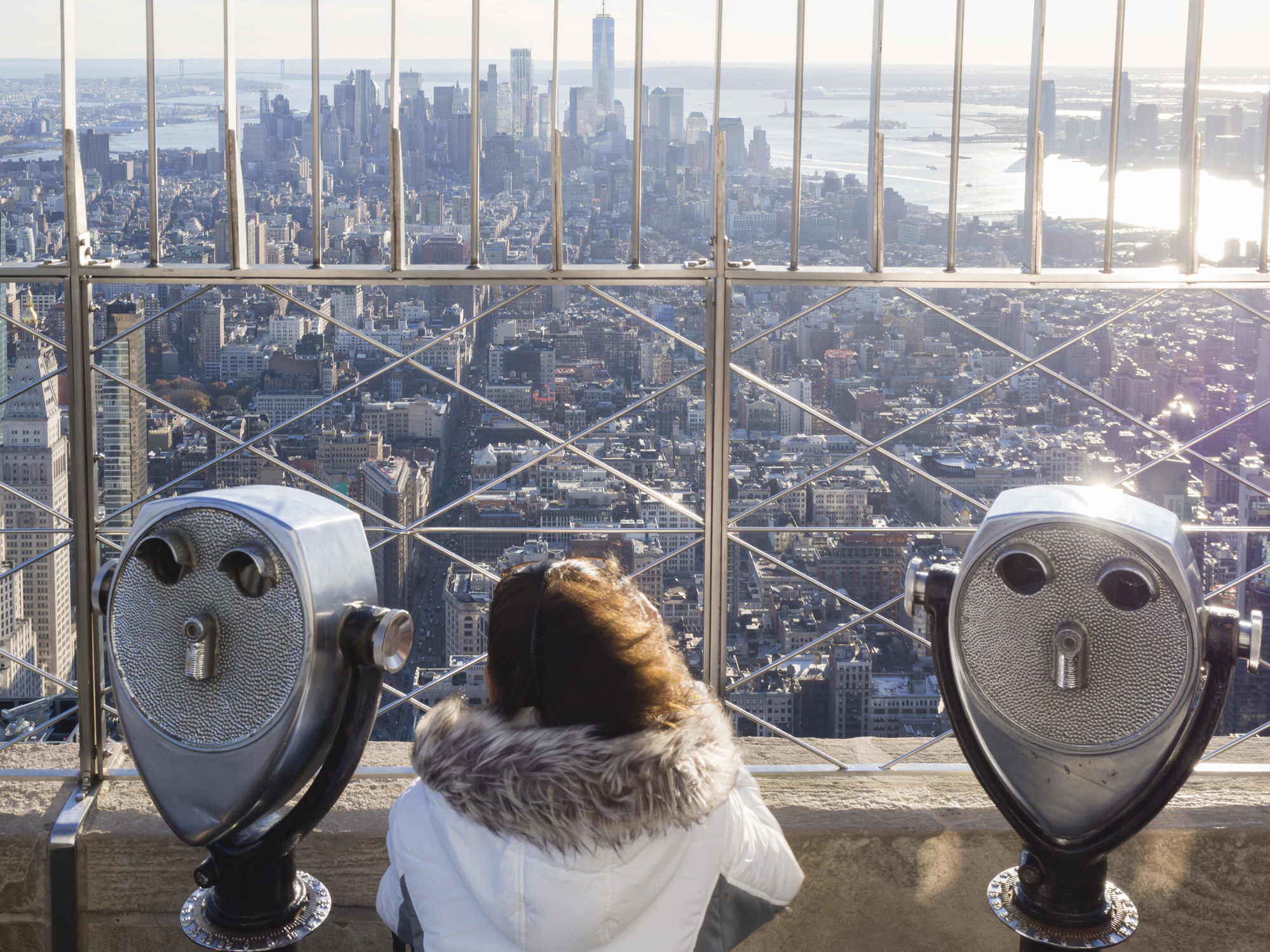 A tourist on the top of the Empire State Building.