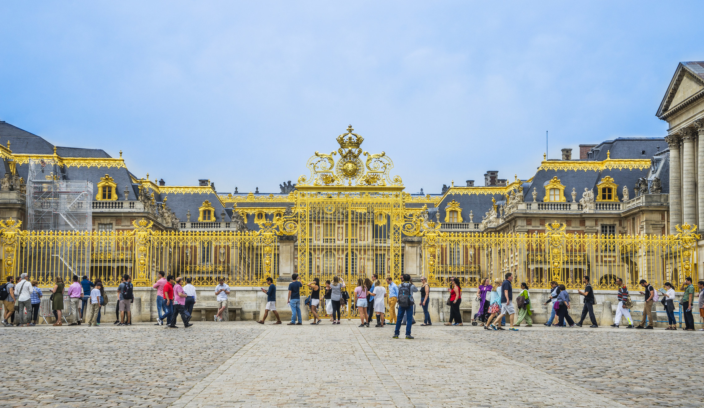 Tourists waiting in line at Versailles.