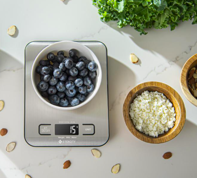 a bowl of blueberries on the scale