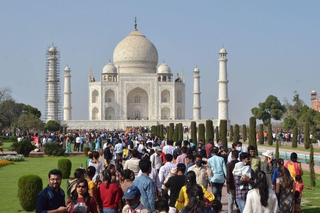 Tourists visiting the Taj Mahal.