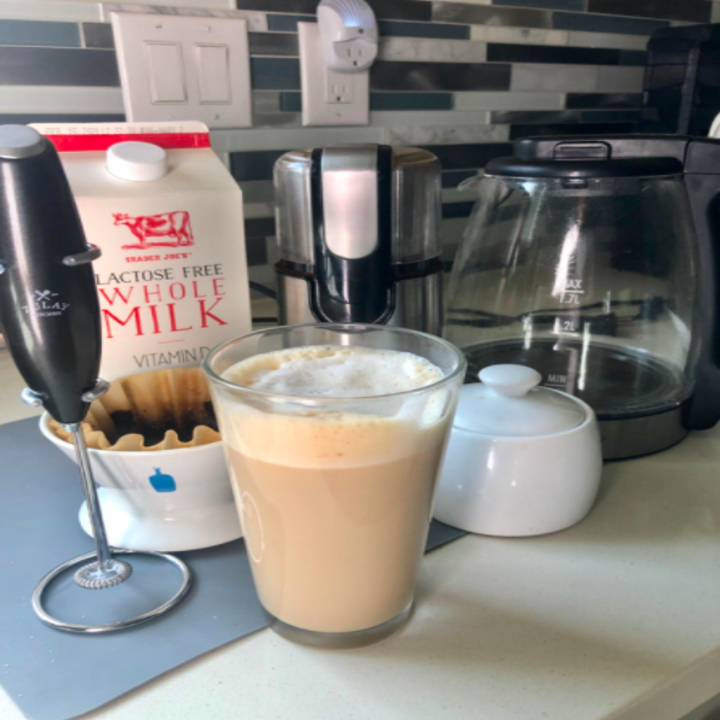 a different reviewer's photo of an ice frothed coffee with the frother in black