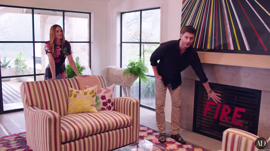 Jensen pointing out the fireplace