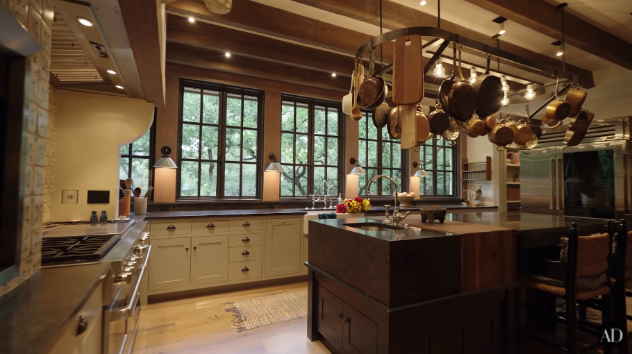 Jared and Genevieve Padalecki's large rustic, beige and brown kitchen