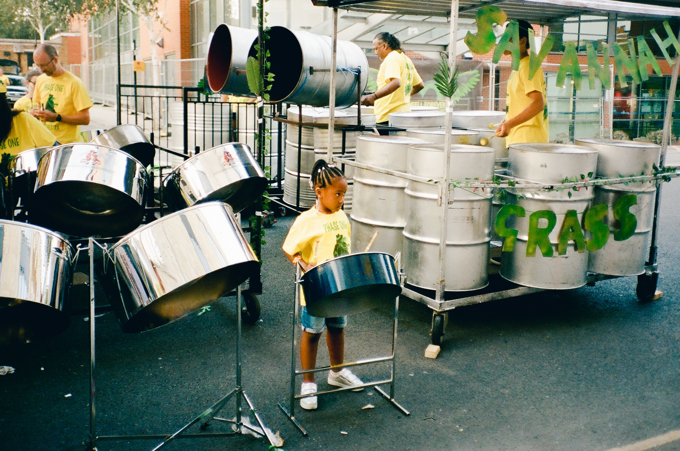 A young girl in front of steel drums at Notting Hill Carnival