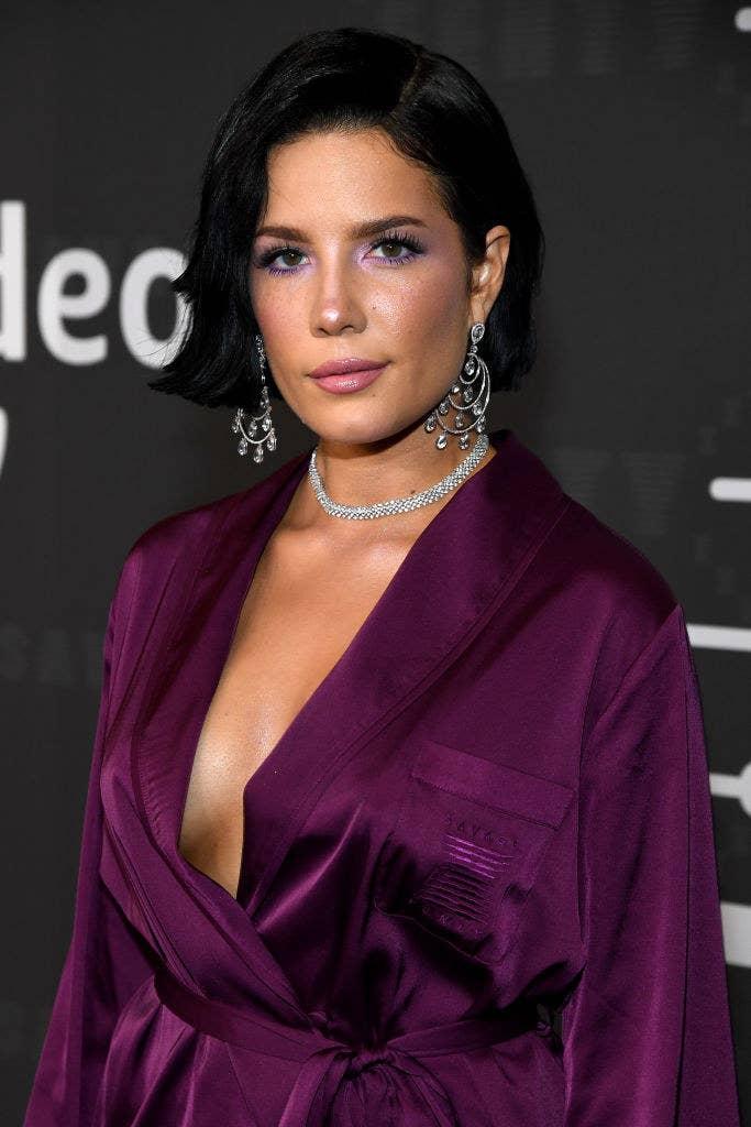 Halsey in a dark Savage X Fenty robe