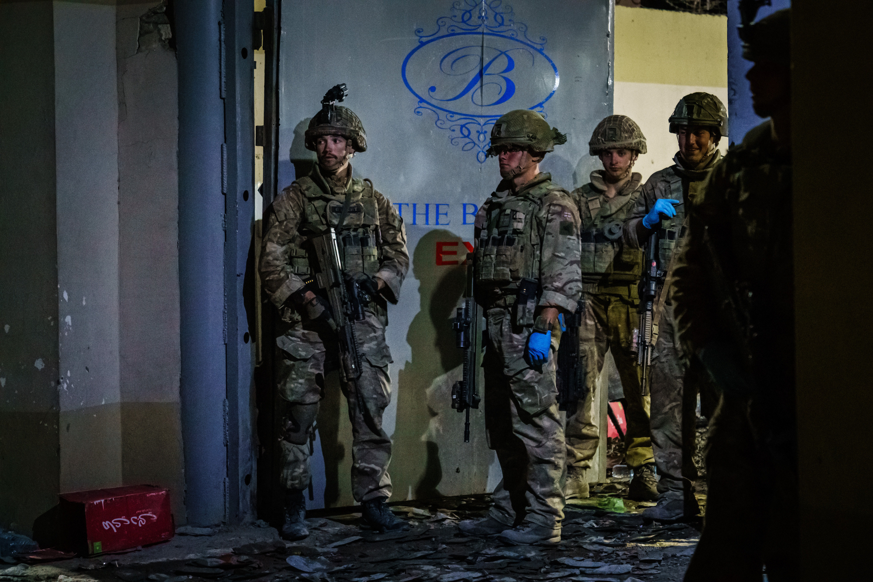 Military troops stand guard outside a hotel in Kabul