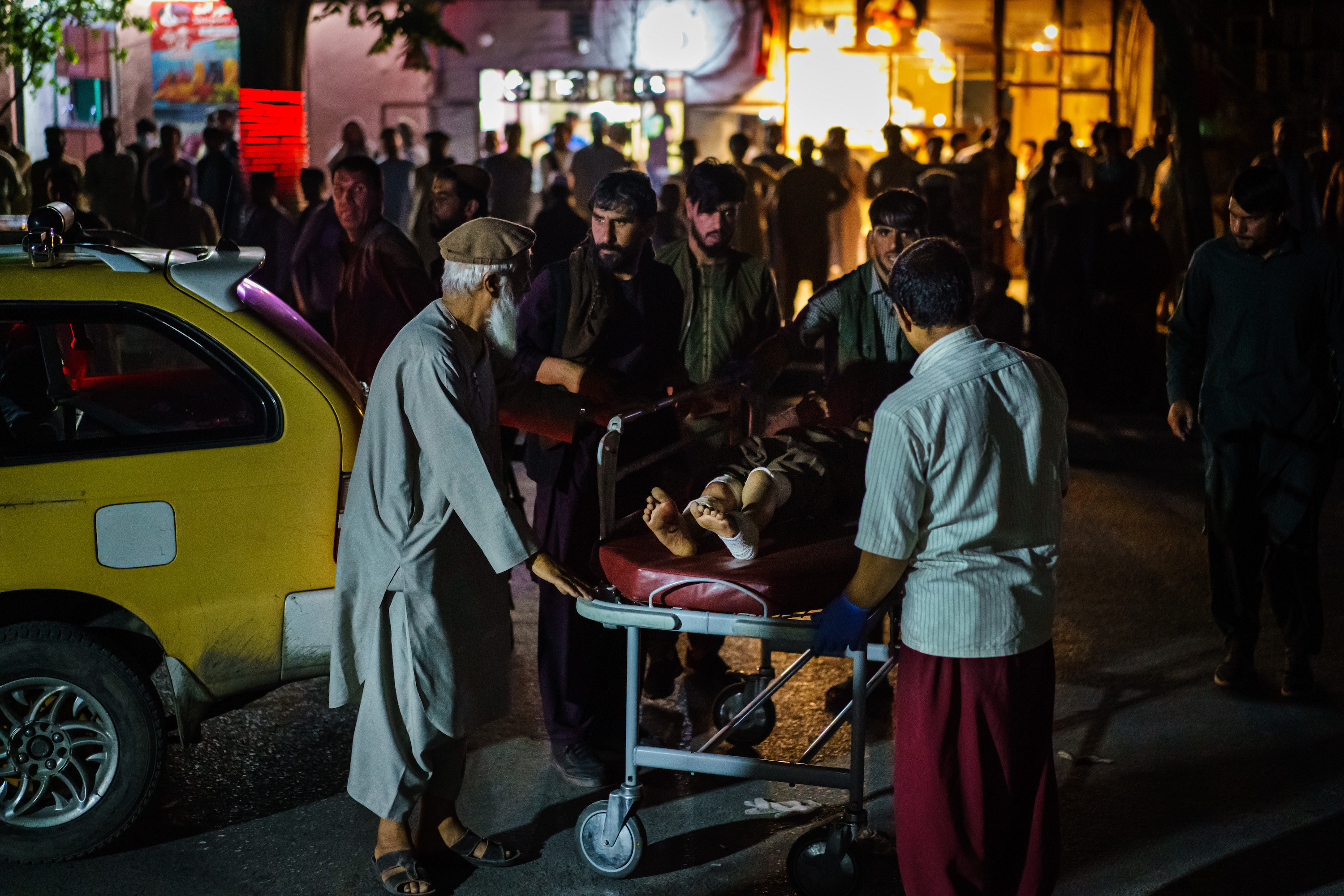 People fill the streets and assist others who were wounded by the explosion