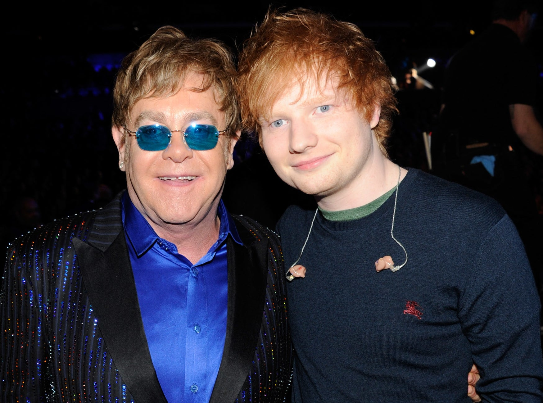 Elton and Ed pose together at a concert