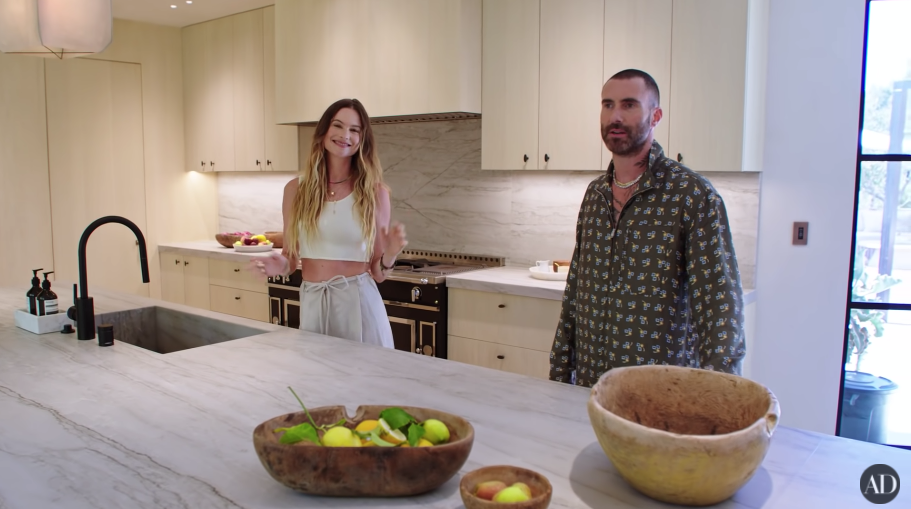 Adam and Behati standing in their kitchen