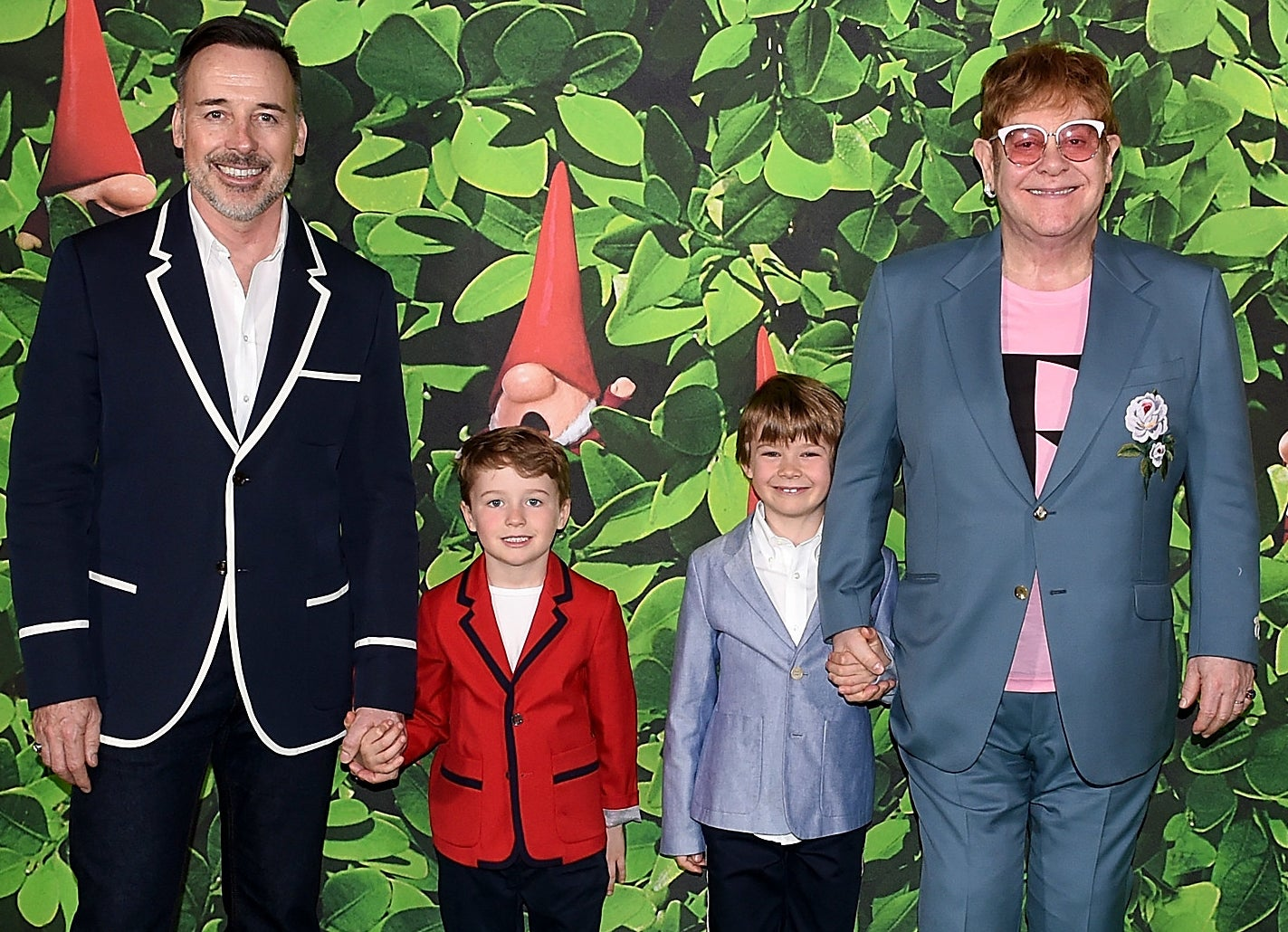 Elton and David hold hands with their two sons