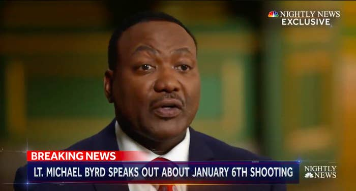 """A screengrab from a news broadcast shows a man speaking above a chyron that reads """"Lieutenant Michael Byrd speaks out about January 6th shooting"""""""