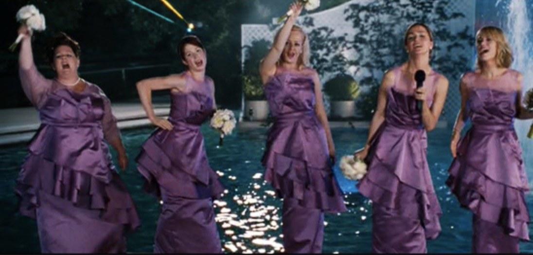 Bridesmaids singing in a pool