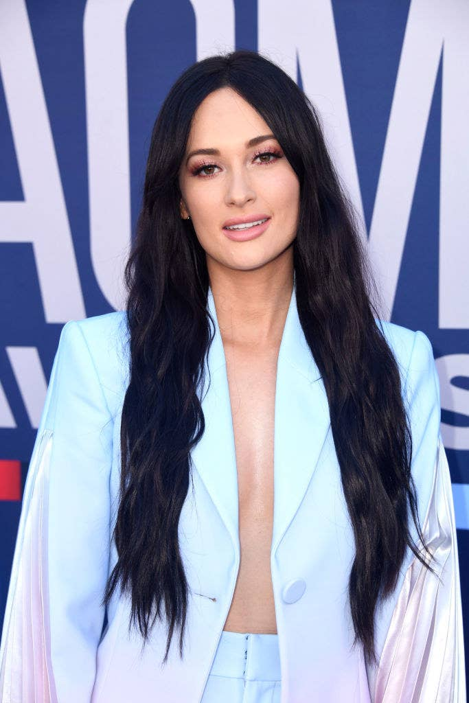 Kacey Musgraves attends the 54th Academy Of Country Music Awards wearing an open jacket and matching pants