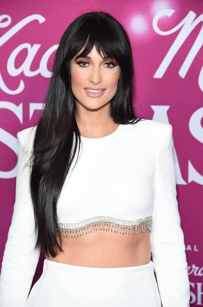 """Kacey Musgraves attends the screening of the """"The Kacey Musgraves Christmas Show"""" in long-sleeved crop top with beading"""
