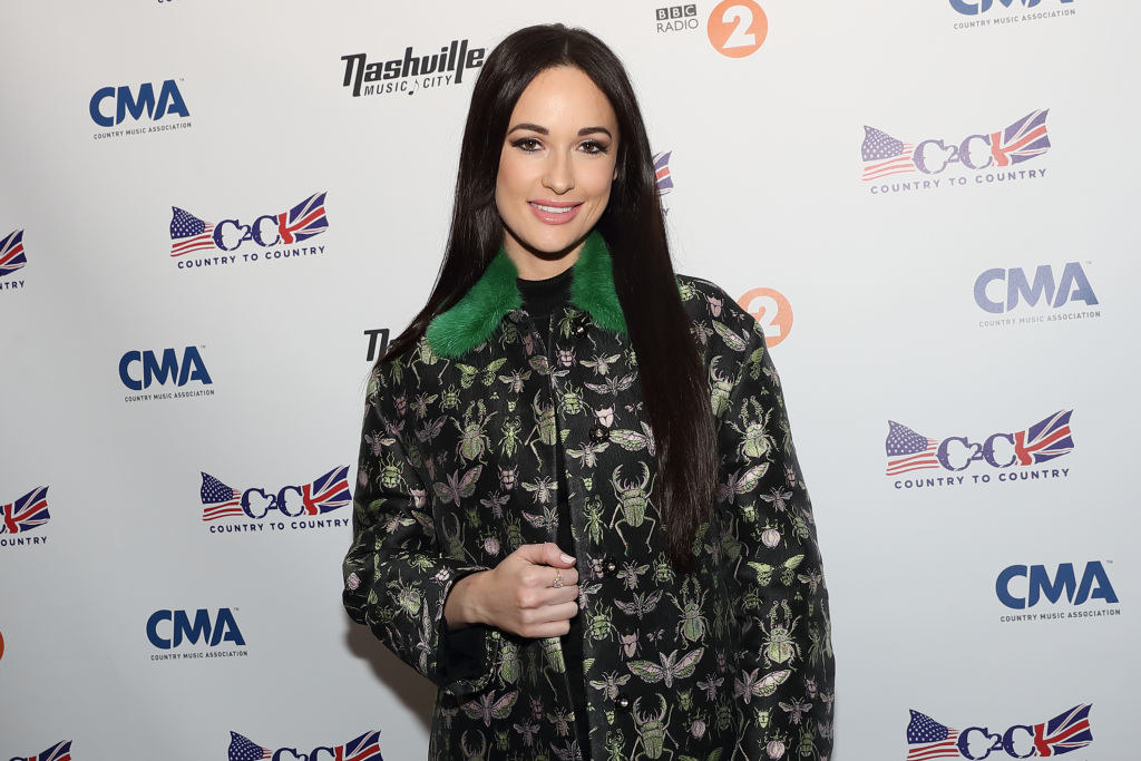 Kacey Musgraves wearing Red Valentino coat poses during a photocall on day 2 of C2C Country to Country festival