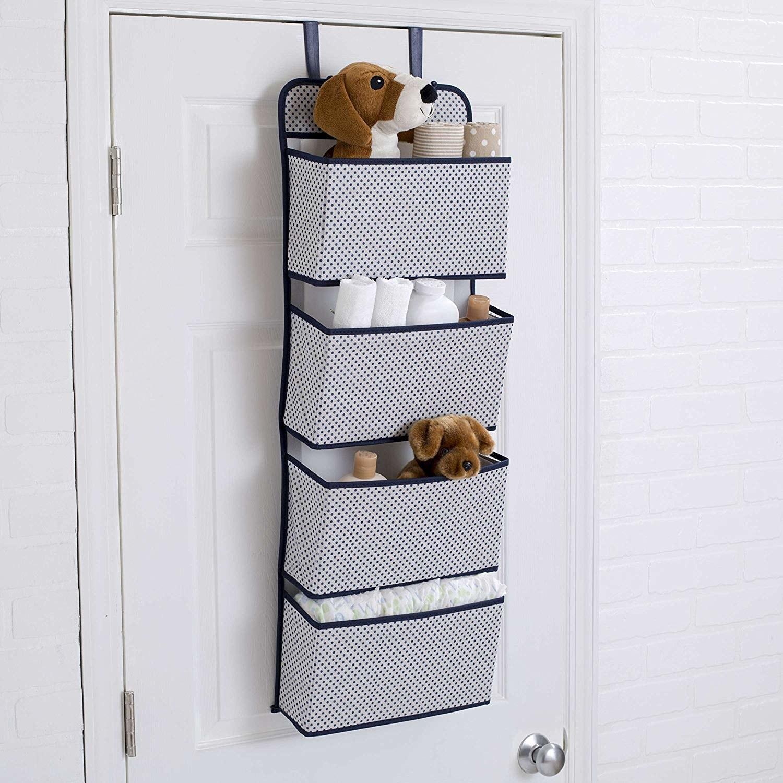 A 4-pocket door hanging organiser with towels and bathroom necessities