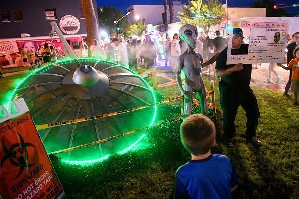 aliens, cosplayers, and neon lights abound