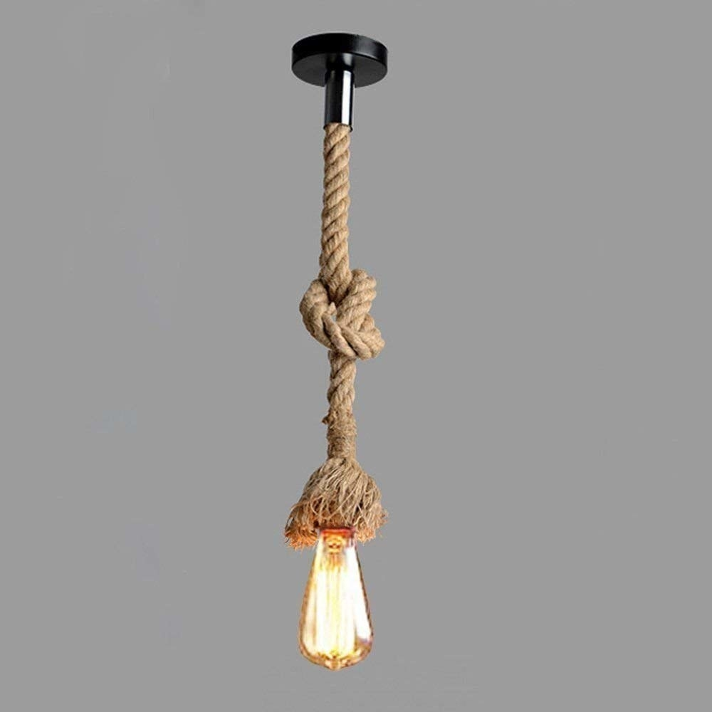 A single hanging bulb from a bendable rustic rope tied in a knot from the ceiling
