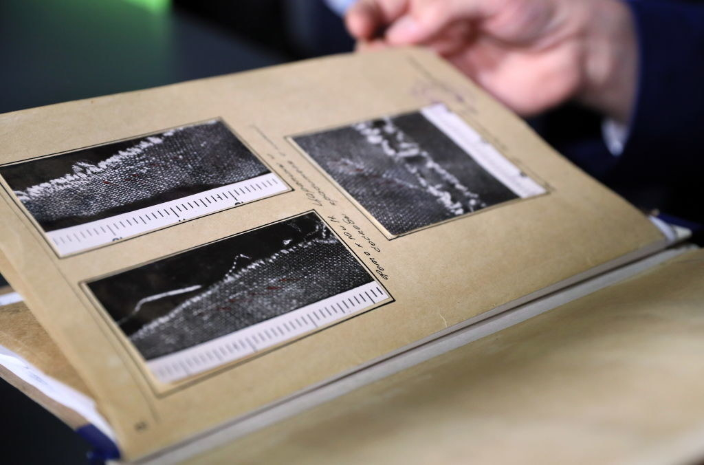 A document with photos from the original investigation into the accident