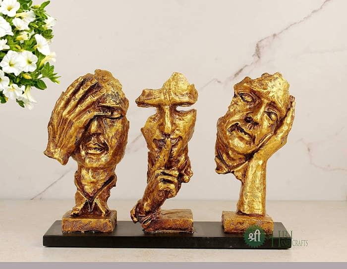 Set of 3 modern face sculptures with different hand actions like one hand on eyes, a single finger on the lips