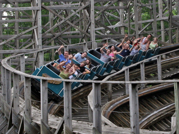 amusement park with wooden roller coaster