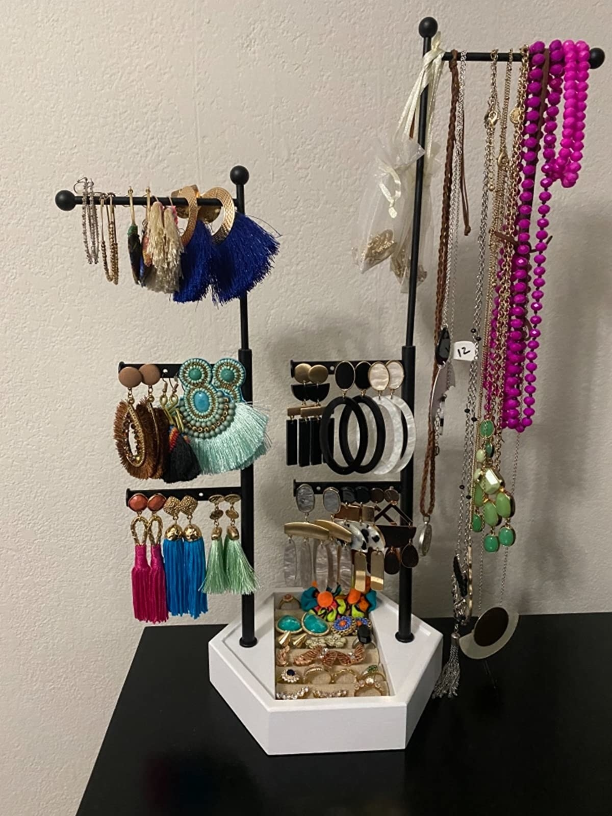 reviewer image of jewelry organized on the jewelry tree stand