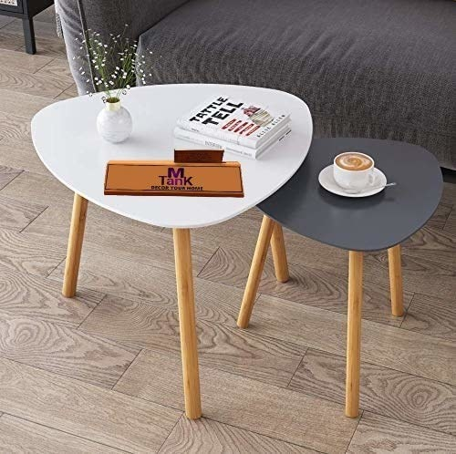 Two coffee tables in white and grey in a triangular shape with wooden legs