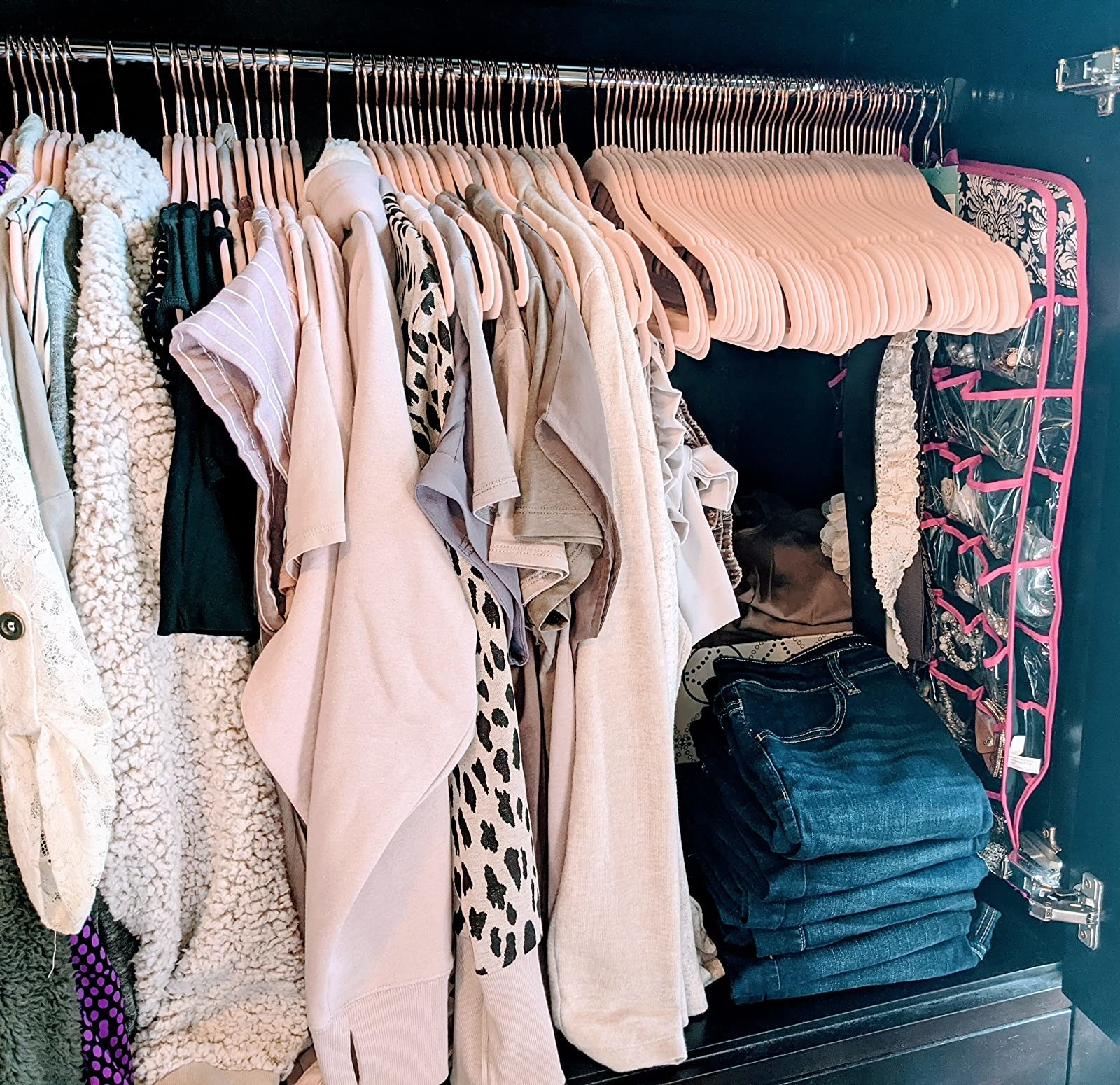 A customer's closet filled with clothes hanging from light pink SONGMICS Velvet Hangers