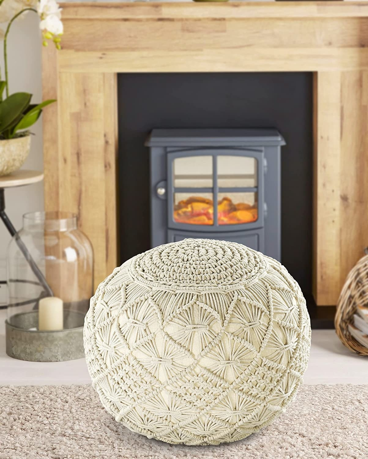 A knitted beige macrame inspired pouffe