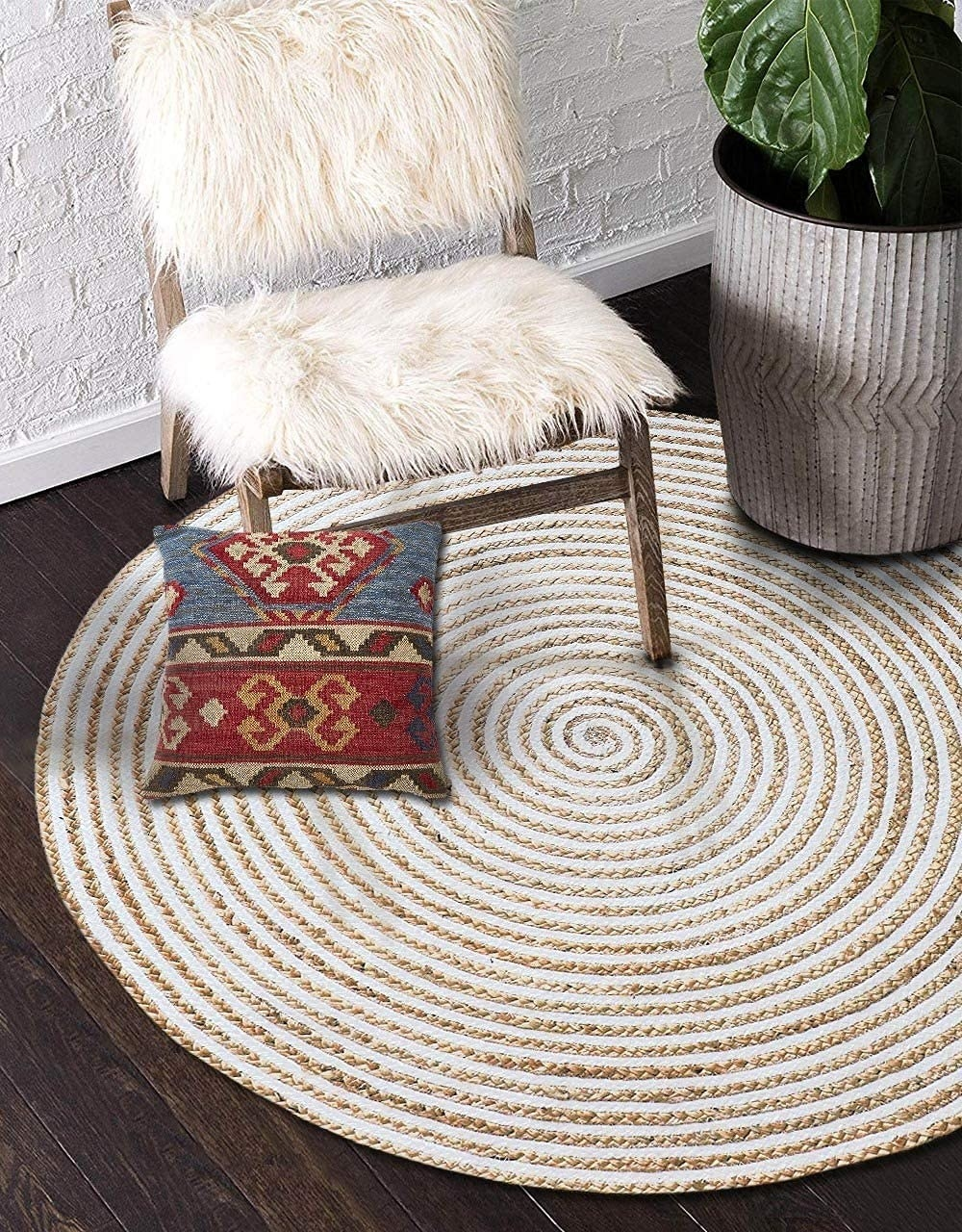 A round braided gold and beige rug