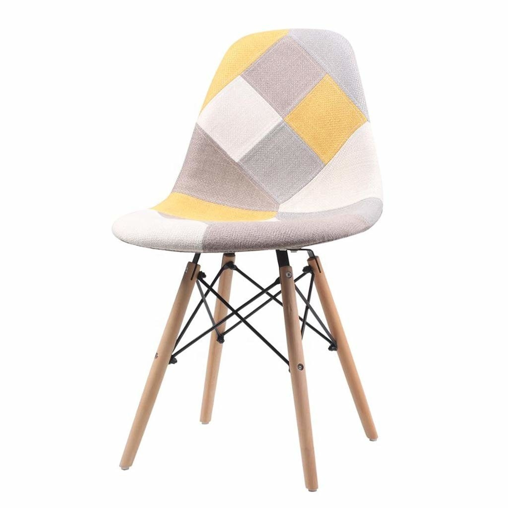 A chair with a patchwork design in the colours white, yellow and grey