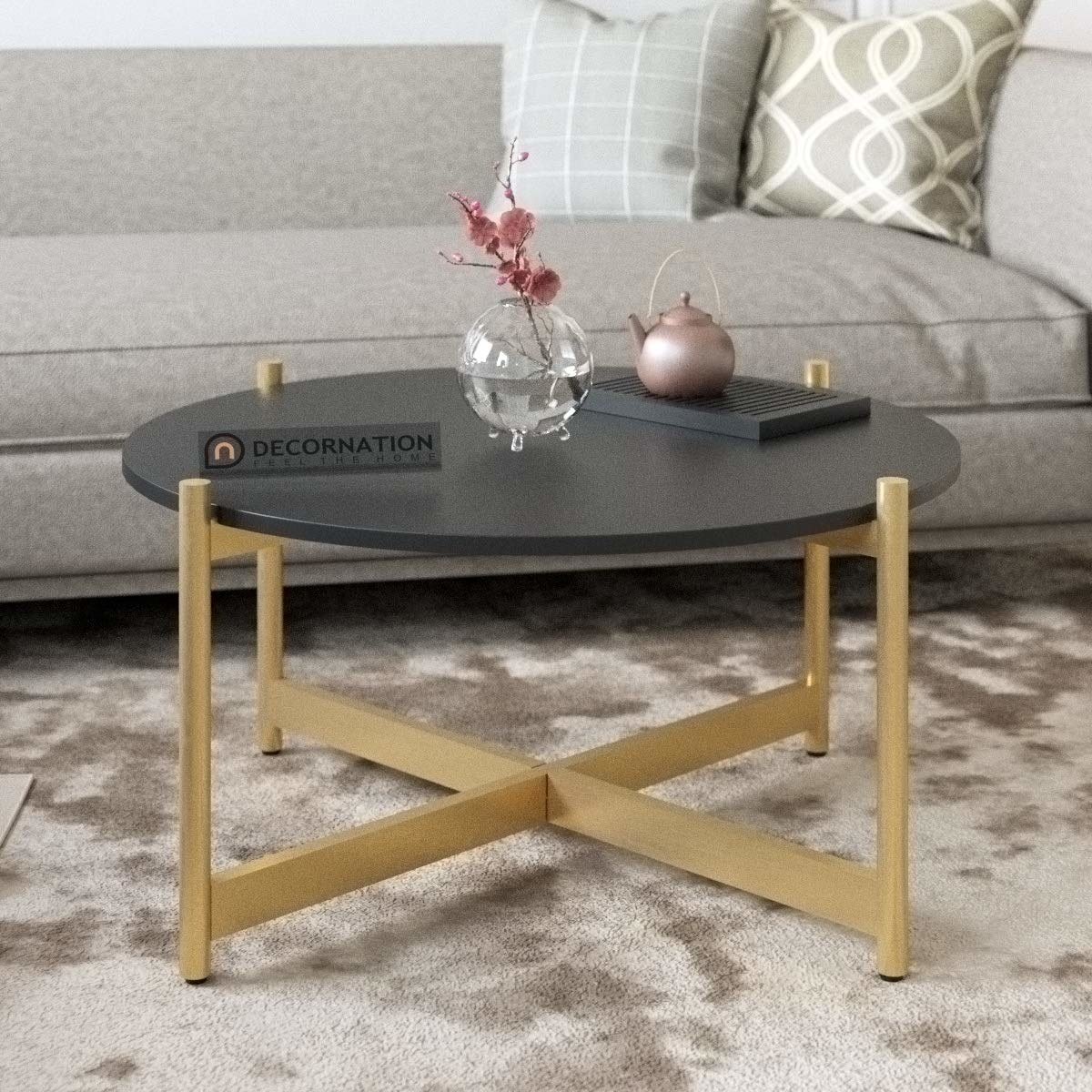 A coffee table with a black top and golden legs