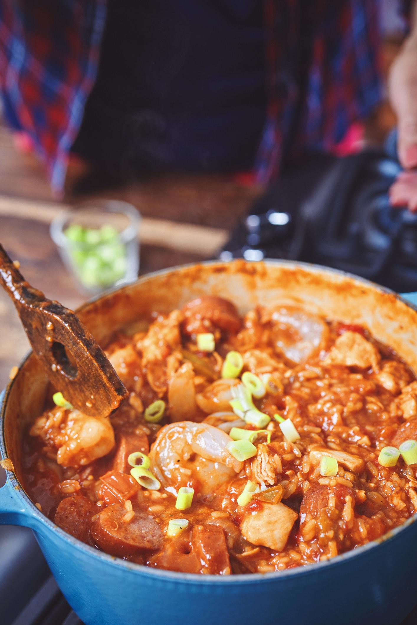 Stirring a pot of jambalaya.
