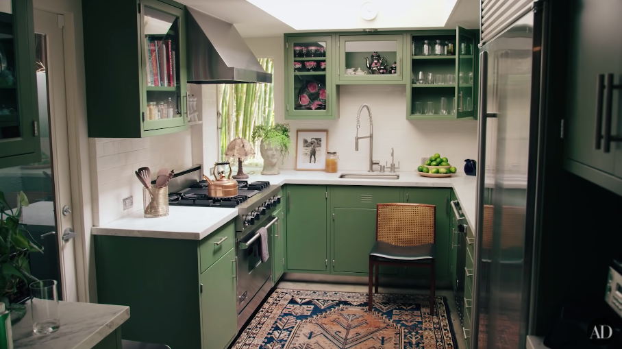 Another image of green-themed kitchen