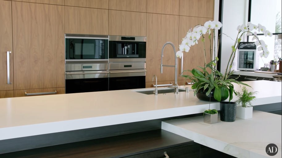 Another view of his spare kitchen with white counter space