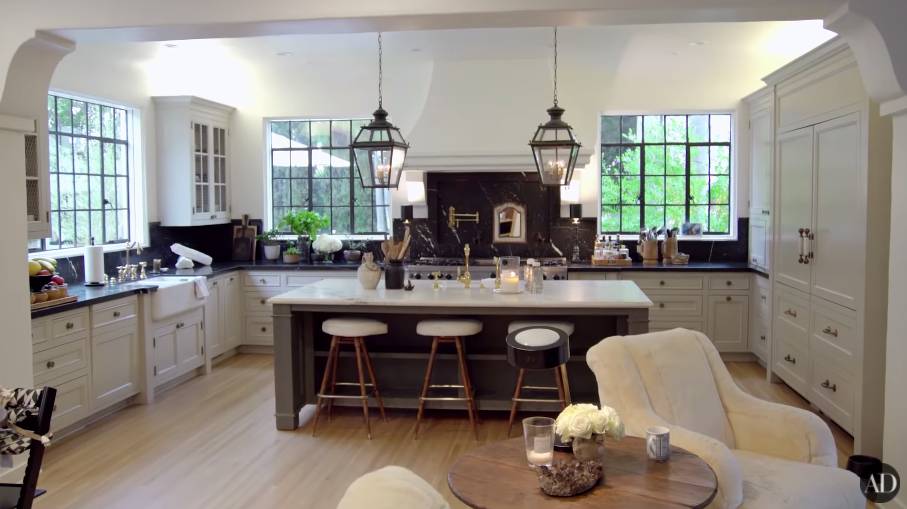 Another shot of their large kitchen, with an island with stools in the middle